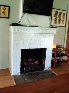 Electric fireplace/heater is warm and cozy