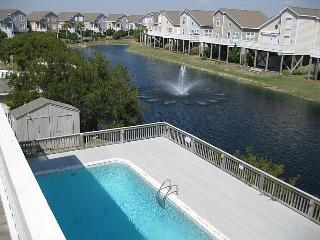 view of pool and lagoon from deck