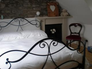 Double bedroom with fresh white bedding and towels