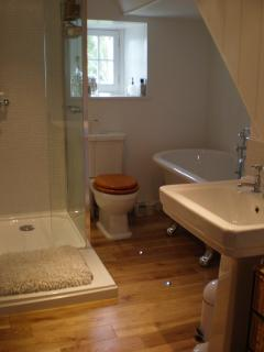 Bathroom with luxury free standing bath and walk in shower