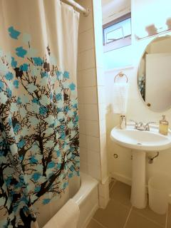 Bathroom with Full Bathtub, Shower, Sink, Toilet, Quality Towels, Hair Dryer