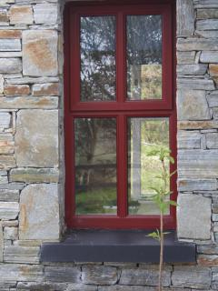 Red window in the cottage