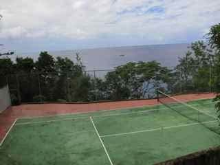 Tennis court and Caribbean Sea
