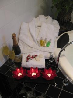 Plush Bathrobes, Slippers, Toiletries & Candles