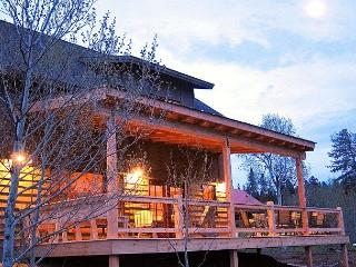 The big covered deck is a great spot for outdoor meals and visiting