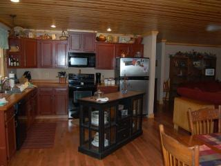 Fully equipped kitchen that is open to the eating/living/sunroom areas.