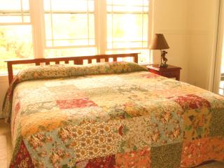 master bedroom w king bed and pillow-top mattress has ocean view and stream view
