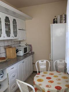 Very well-equipped kitchen has fridge freezer, dishwasher, microwave gas cooker with electric oven