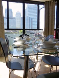 Dining area with view across docks to Canary Wharf