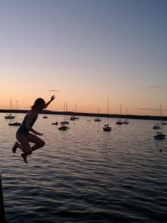 Jumping off the wharf at dusk
