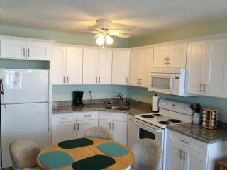 Newly remodeled kitchen with granite countertop
