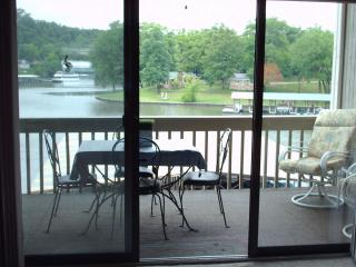 Patio Door to carpeted deck with view of lake