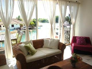 living room with view out to terrace and water
