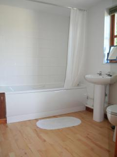 One of large and airy bathrooms.