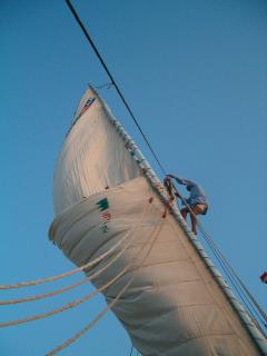 Eid turning in the sail on our felucca Nile Bride after sunset sail