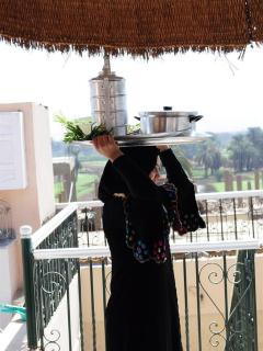 Alam arriving with Egyptian breakfast for guests on the roof