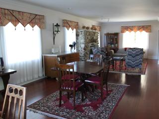 dining and sitting amongst antiques and fireplace