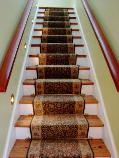 Stairs leading to master suite.