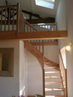 Stairs up to the mezzanine in the 2 bedroom duplex