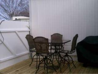 Privacy Fence surrounds back yard.  Deck includes gas grill, as well as shower for washing off sand.