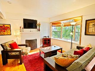 Living room is light and bright with large window to bring in the sunshine