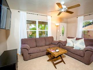 Alternate view of living room showing seating arrangement. The large sofa pulls out into a queen sized bed for additional sleeping space.