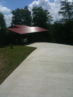 Cabin with large cement driveway and two car garge