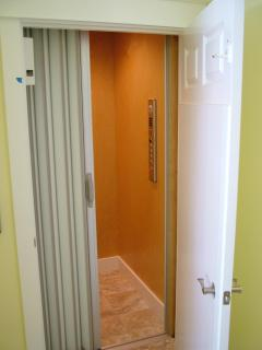 Elevator off kitchen and dining room