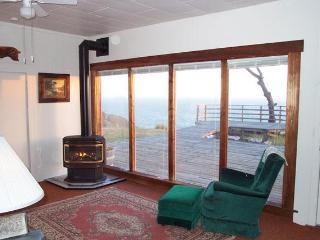 Fireplace room, deck & ocean