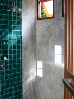Modern bathroom with tropical rain shower