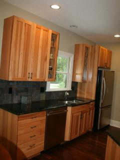 hickory cabinets, granite countertops and walnut floors