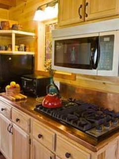 Kitchen snapshot with Viking cook stove, copper countertops and microwave