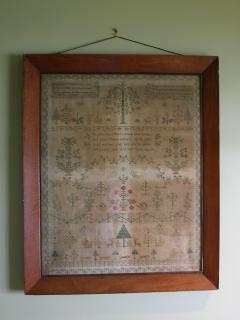 Antique sampler in your bedroom