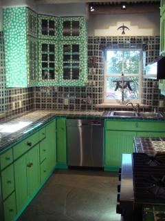 hand painted cabinets, Mexican tile, fun kitchen
