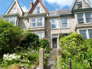 DOLPHINS' WATCH, romantic, character holiday cottage, with a garden in Newlyn, Ref 7472