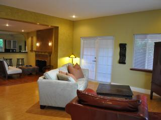 Giant Living Room with French Doors, comfortable seating and large TV