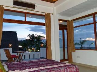 The sun terrace sea view bedroom has stunning views. Wake up to the beautiful ocean in the morning.