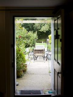Door from lounge to cottage garden