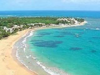 VIEW OF BEACH FROM CONDOMINIUM BALCONY