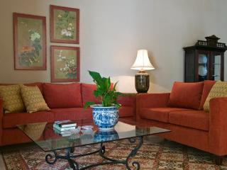 The living room, with carefully chosen beautiful artwork, comfortable custom furniture and antiques