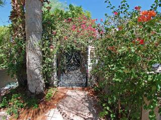 Private front entrance with hand made wrought iron gate