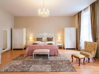 King size bed in the shabby-chic bedroom