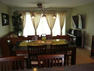 Spacious living/dining area, 54' flatscreen HDTV and a 6-seat dining table, from the back....