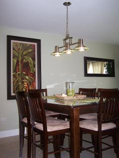 Enjoy your family dinner in your unit at this 6-seat pub-style dining table.