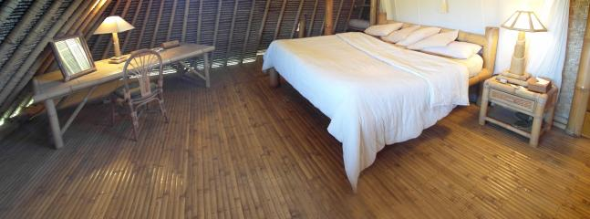 3 bedrooms with desk, massage table, private bath and beach view