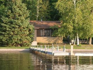 View of secluded log cabin located on shores of Gull Lake, Nisswa, MN - Lakefront Vacation Cabini