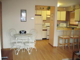 Kitchen and dining area - notice the nice wood floors!