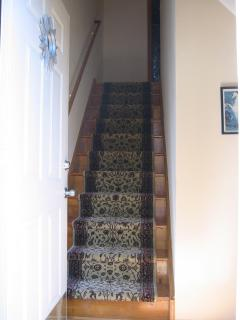Entrance to townhouse - up a flight to the two bedrooms and full bath or down two stair to the LR