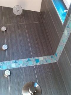 tiled and jetted shower