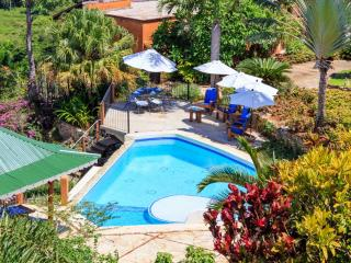 Our residence has a spacious pool area with lounge chairs and barbeque,